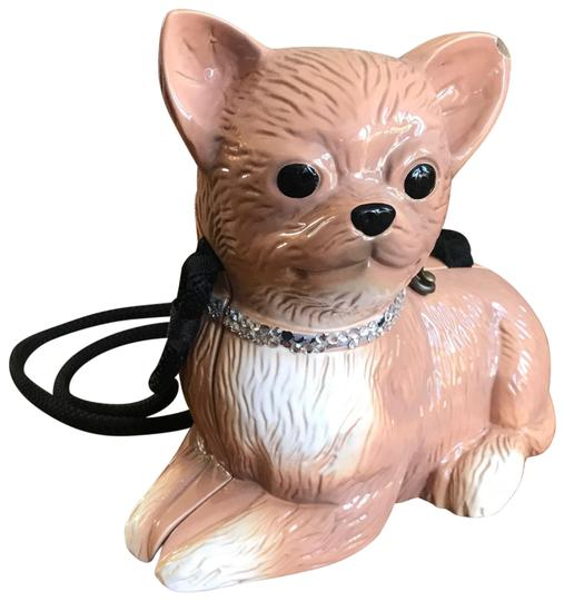 Preload https://img-static.tradesy.com/item/26606985/timmy-woods-chihuahua-dog-brown-plastic-cross-body-bag-0-1-540-540.jpg