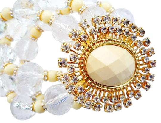 Preload https://img-static.tradesy.com/item/2661544/kate-spade-crystal-and-cream-looking-glass-very-rare-absolutely-stunning-bracelet-0-2-540-540.jpg