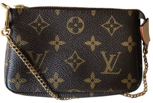 Louis Vuitton Luxury Leather Monogram Gold Wristlet in Brown