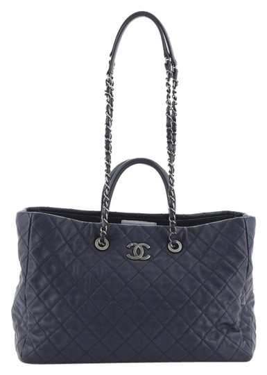 Preload https://img-static.tradesy.com/item/26649862/chanel-shopping-coco-handle-quilted-caviar-blue-leather-tote-0-1-540-540.jpg