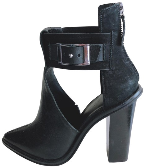 Preload https://img-static.tradesy.com/item/26652293/tibi-black-buckle-cut-out-heeled-bootsbooties-size-eu-365-approx-us-65-narrow-aa-n-0-2-540-540.jpg
