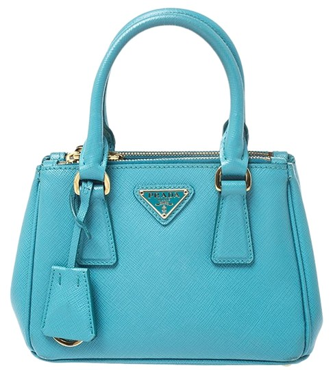 Preload https://img-static.tradesy.com/item/26667879/prada-double-lux-turquoise-saffiano-mini-zip-blue-leather-tote-0-1-540-540.jpg