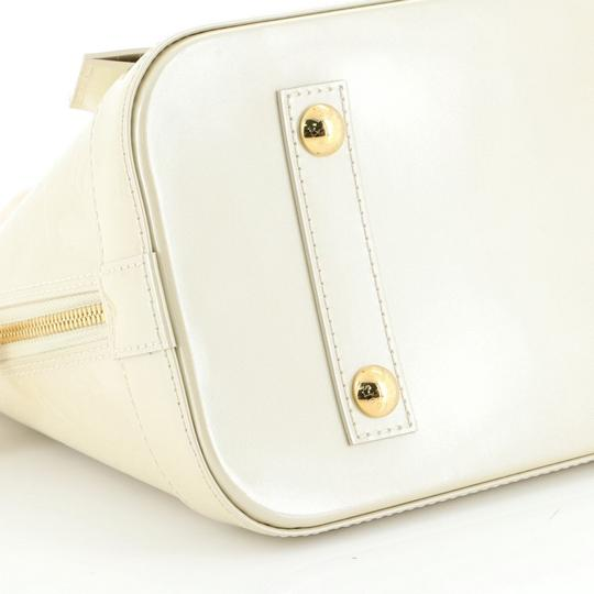 Louis Vuitton Alma Leather Satchel in neutral Image 4