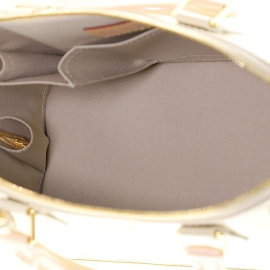 Louis Vuitton Alma Leather Satchel in neutral Image 6