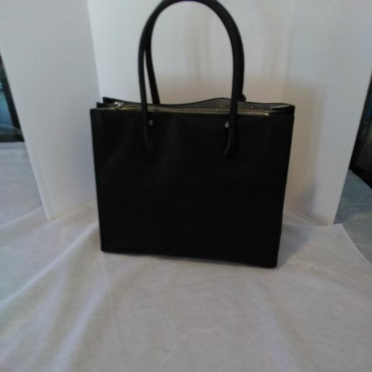 Michael Kors Tote in Mercer Stud & Grommet Charcoal black handbag. Gorgeous. Large center zipper pocket, key chain. 2,nd zipper lg pocket inside lg pocket. Image 1
