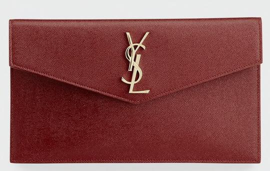 Preload https://img-static.tradesy.com/item/26674087/saint-laurent-ysl-pouch-deep-red-textured-leather-clutch-0-3-540-540.jpg