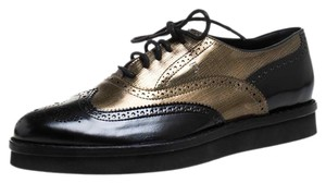 Tod's Gold Leather Lace Black Flats