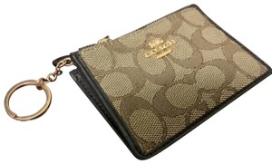 Coach Wristlet in Brown and Gold