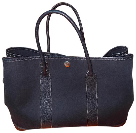 Preload https://img-static.tradesy.com/item/26769228/hermes-garden-party-size-30-canvas-and-black-tote-0-2-540-540.jpg