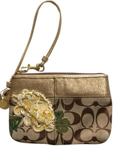 Coach Wristlet in Tan with gold trim