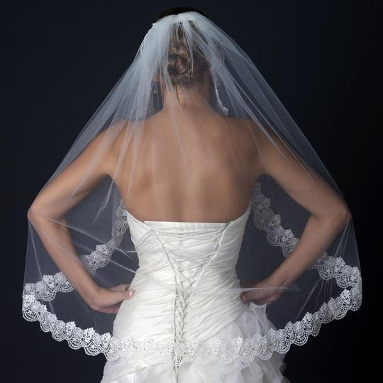 Preload https://item1.tradesy.com/images/elegance-by-carbonneau-ivory-fingertip-wedding-veil-with-scaliop-floral-embroidery-2683075-0-0.jpg?width=440&height=440