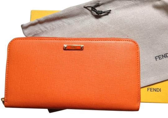Preload https://img-static.tradesy.com/item/2683774/fendi-tangerine-zippered-walletsale-wallet-0-3-540-540.jpg