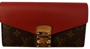 Louis Vuitton Brown and red leather Clutch