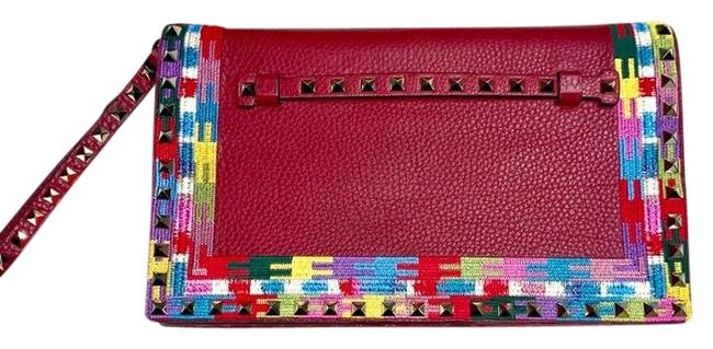 Item - Rockstud Embroidered Trim Ruby Red Leather Clutch