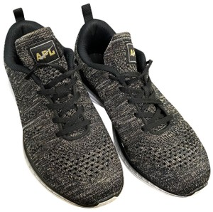 Athletic Propulsion Labs black and gold Athletic