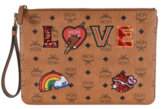 Preload https://img-static.tradesy.com/item/26872621/mcm-new-cognac-visetos-love-patch-pouch-brown-coated-canvas-and-leather-wristlet-0-0-540-540.jpg
