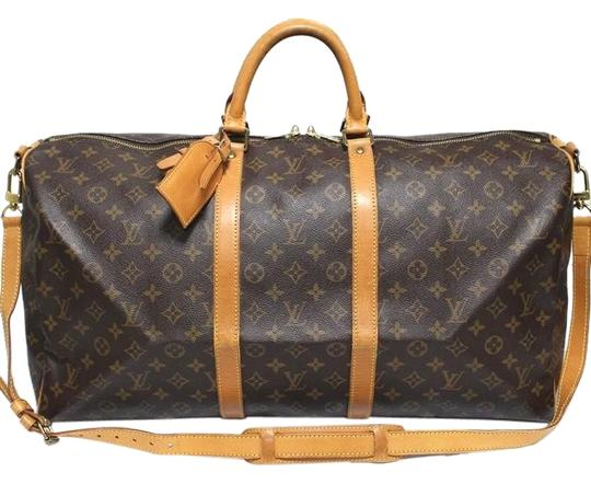 Preload https://img-static.tradesy.com/item/26872810/louis-vuitton-keepall-lv-55-bandouliere-with-strap-name-tag-poignet-brown-canvas-weekendtravel-bag-0-1-540-540.jpg