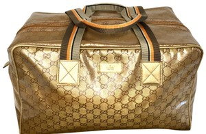 Gucci gold Travel Bag