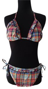 Victoria's Secret Victoria's Secret ruffled plaid string bikini top and bottom. Top size Small, Bottom size Medium. Set.