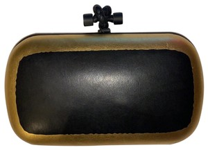 Bottega Veneta Black and Gold Clutch