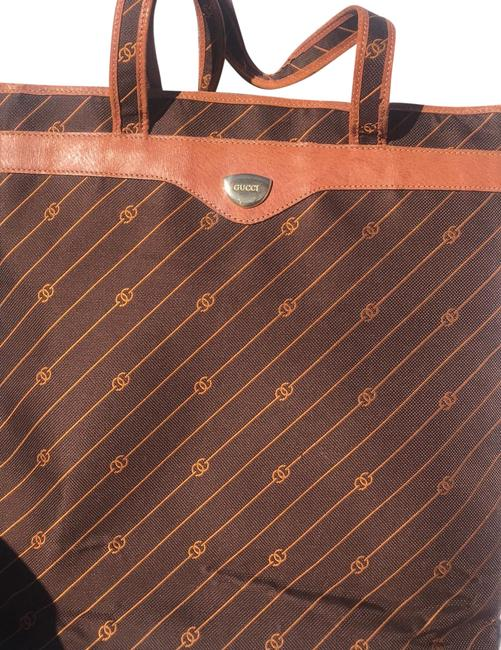 Item - Oversized Trim Tote Chocolate Brown with Copper Gg Logo Leather and Canvas Weekend/Travel Bag