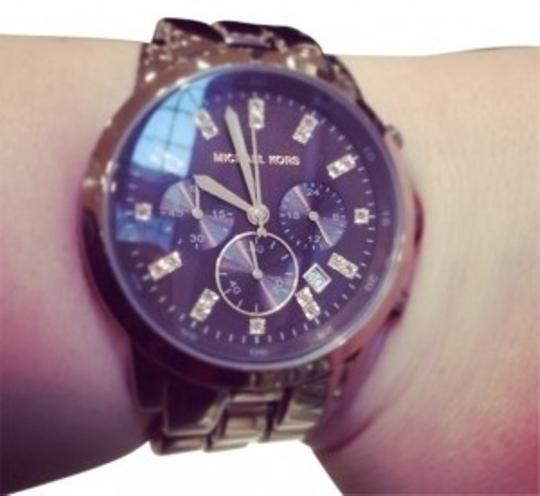 Preload https://item3.tradesy.com/images/michael-kors-espresso-mid-size-showstopper-chronograph-watch-26972-0-0.jpg?width=440&height=440