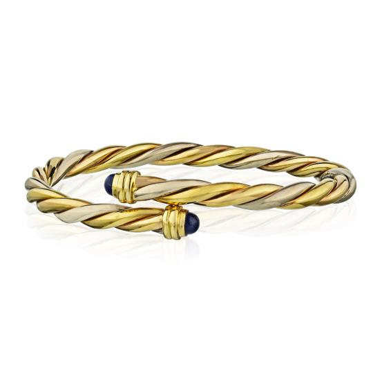 Preload https://img-static.tradesy.com/item/26979542/cartier-gold-vintage-lapis-lazuli-twisted-bypass-bangle-bracelet-0-1-540-540.jpg