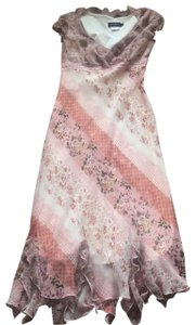 multi floral Rose cream color ruffles on the bottom Maxi Dress by CDC Caren Desiree Company