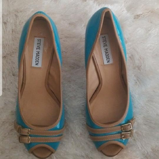 Preload https://item2.tradesy.com/images/steve-madden-aqua-blue-and-cream-peep-toe-sandals-pumps-size-us-75-regular-m-b-2706916-0-1.jpg?width=440&height=440
