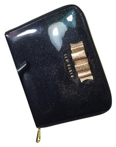Ted Baker Case Black / gold sparkle design /gold bow Clutch