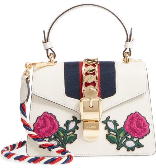 Preload https://img-static.tradesy.com/item/27158082/gucci-sylvie-new-mini-floral-embroidered-white-leather-cross-body-bag-0-1-540-540.jpg