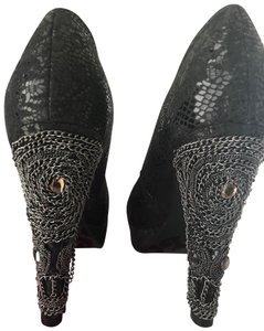Not Rated Black with stones on heels. Never worn. Platforms