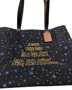 Coach Tote in Black with blue stars and shiny gold letters