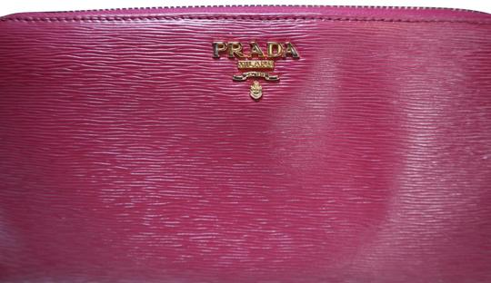 Preload https://img-static.tradesy.com/item/27217886/prada-pink-long-saffiano-wallet-0-5-540-540.jpg