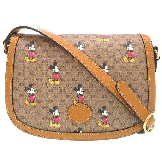 Preload https://img-static.tradesy.com/item/27218377/gucci-disney-small-602694-0016gucci-brown-gg-supreme-leather-shoulder-bag-0-0-540-540.jpg