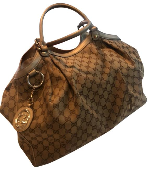 Item - Sukey Large Tan and Gold Canvas Leather Hobo Bag