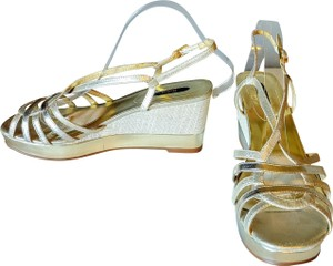 Reba Leather Fabric Gold Wedge Wedges