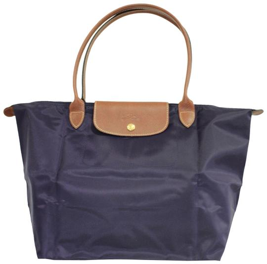 Preload https://img-static.tradesy.com/item/27304754/longchamp-foldable-navy-blue-nylon-tote-0-1-540-540.jpg