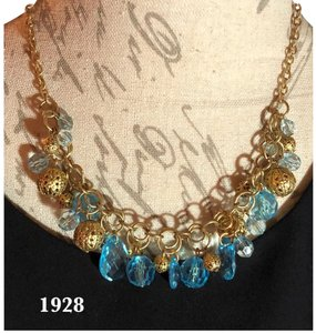 1928 1928-GORGEOUS GOLD-TONE COSTUME NECKLACE WITH OPAQUE AQUA BEADS AND GOLD-TONE DECORATIVE GOLD BALLS
