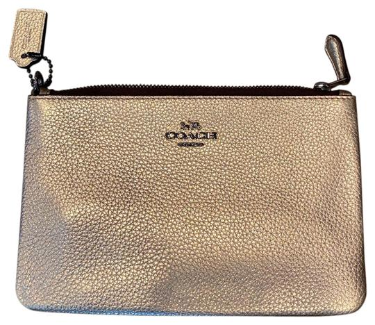 Preload https://img-static.tradesy.com/item/27324653/coach-gold-metallic-wristlet-wallet-0-3-540-540.jpg