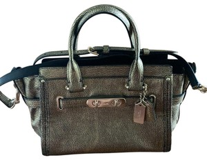 Coach Satchel in Black and Gold