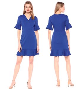 Trina Turk short dress Blue Ruffle Fit And Flare Bell Sleeve Quest on Tradesy