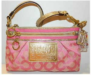 Coach Poppy Baguette Clutch Mini Pink Wristlet in Pink-Gold