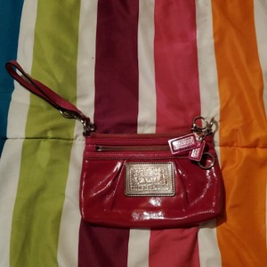 Coach Wristlet in Pink with silver hardware