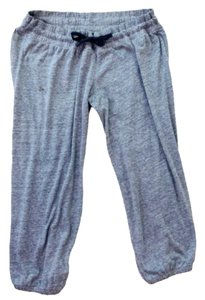 """Under Armour Under Armour Jogger Pants Sweatpants Light Weight Light Gray Size Medium True to size, also has an adjustable drawstring Measures approximately: 28"""" long 15"""" across waist 22"""" Inseam Great condition"""