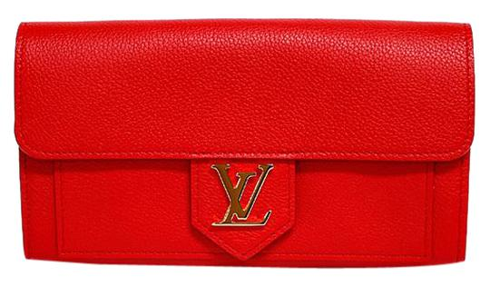 Preload https://img-static.tradesy.com/item/27403861/louis-vuitton-ruby-ruby-ruby-portofeuil-lock-me-m61277-folded-soft-calf-leather-ladies-wallet-0-1-540-540.jpg