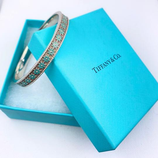 Preload https://img-static.tradesy.com/item/27405851/tiffany-and-co-sterling-silver-daisy-flower-blue-enamel-bangle-bracelet-0-0-540-540.jpg