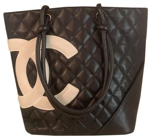 Chanel Tote in black leather with white C. pink lining