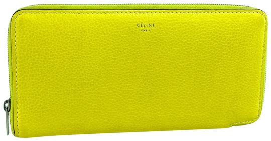 Preload https://img-static.tradesy.com/item/27510694/celine-yellow-leather-large-zipped-multifunction-14cel618-wallet-0-1-540-540.jpg
