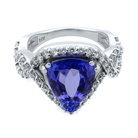 Preload https://img-static.tradesy.com/item/27510864/14k-white-gold-pear-cut-tanzanite-and-diamond-crossover-size-7-ring-0-0-540-540.jpg